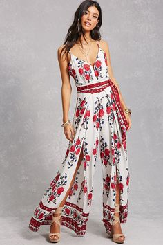 A woven jumpsuit featuring a double cami strap design that cross at the back, a V-neckline, a front keyhole cutout, a self-tie sash, split wide-leg design, and a concealed zipper at the back.<p>- This is an independent brand and not a Forever 21 branded item.</p>