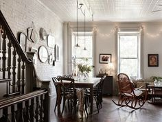 all white room with brick whitewashed wall and white tin ceiling
