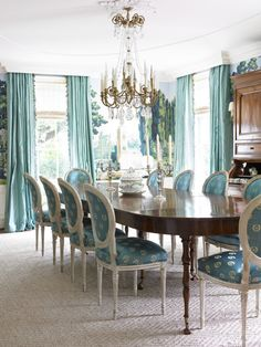 I am drawn into this dining room by picture alone. The soft, muted colors of turquoise are beyond beautiful. I am in love.