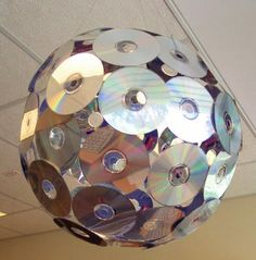 I don't know whether this is kitsch or a good idea. Certainly a great idea for making a cheap disco ball for a school dance, but maybe not such a good idea for the home.