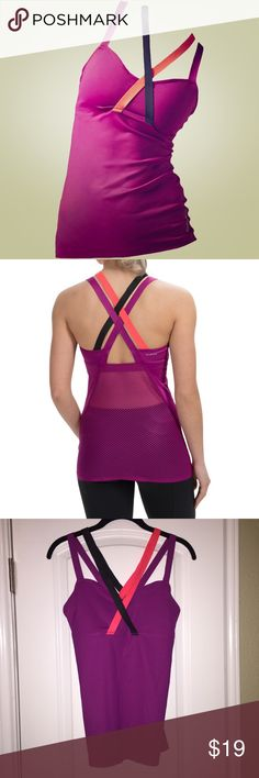 Reebok Cardio Cross Strap Workout Tank Purple strappy tank has sheer mesh back with cooling Playice technology and strong inner shelf bra. Reebok Tops Tank Tops