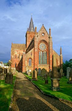 St Magnus Cathedral, Kirkwall, Orkney, Scotland. Founded by Norseman, Reginald of Orkney in 1137. In the cavernous and shadowy nave, shafts of sunlight spill through heavy Norman arches to illuminate old tombs and shrines. High overhead carved corbels represent Vikings from 900 years ago Stunningly beautiful cathedral