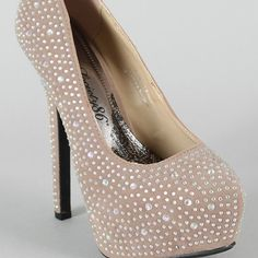 """Crystal and suede heels With this stunning pump, you'll be the center of attention all evening long. Features faux suede upper with sparkling jewels throughout, almond toe, scoop vamp, hidden platform and wrapped heel. Finished with padded insole. Heel height 5.95"""" with 2"""" platform. Shoes may run about half a size small. Various sizes available in both colors. Shoes Heels"""