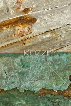 close-up shot of metal nailed on wood. - Detailed shot of nailed metal on wooden plank.
