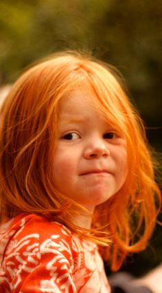 Adorable. I love redheaded kids. Freckles are so cute. I want at least one redhead.