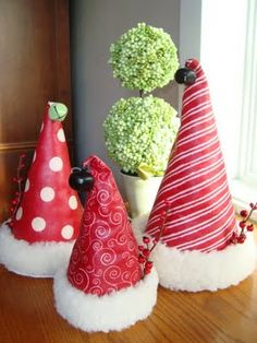 Christine's Favorite Things: Santa Hat Tutorial. Wonder if you could use small sytrofoam cones, wrapping paper and firm to make small place cards using this idea?