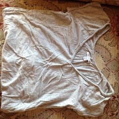 American Eagle tee shirt Cute grey comfortable tee from American eagle. Ruffly bottom and gently worn. Is an XS but fits more like a S/M. American Eagle Outfitters Tops Tees - Short Sleeve