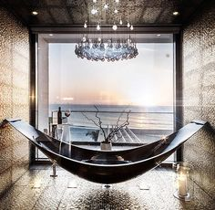 The Hammock and freestanding bathtub by SplinterWorks in carbon fibre and gold, which takes stylish relaxation to a new level.