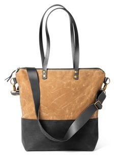 Tan and black waxed canvas and leather tote $150 by Gillian Hyde of Pip Robins Accessories, Toronto, ON, New More at: http://www.oneofakindshow.com/toronto/artisans.php?m=2&id=518571