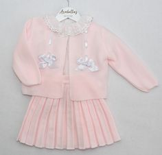 Arabella's Baby Boutique VB by Juliana, baby pink three piece knitted set, knitted cardigan and skirt with frilly neck blouse and white bow detail.  Beautiful set for winter.  Spanish girls dress set