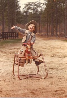 The happiest cowboy on his rocking horse
