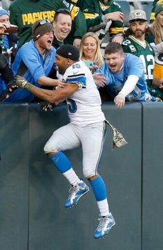 Golden Tate celebrating surrounded by salty cheeseheads