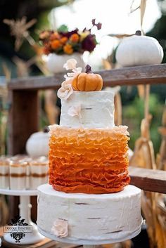 A very cool tired cake with an orange ombre ruffle mid tier, and a pumpkin topper. Note: I think this is from a styled shoot. {Photo unknown}