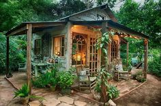 """This tiny building makes the most of outdoor space. Ample glass draws the view outward, to the expansive space beyond. And porches create extra """"rooms"""" (that are way less expensive to build). These are among the strategies for making any space feel larger without adding any actual inside area."""