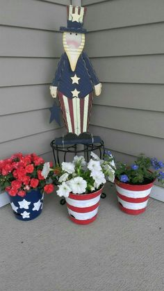 Painted flower pots with red, white & blue flowers