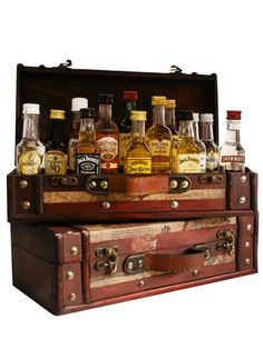 A classy wood and faux leather trunk filled with 12 assorted 50 ml airplane-size bottles of liquor (aka shot bottles, mini bottles, or mini bar bottles) Alcohol Gift Baskets, Liquor Gift Baskets, Alcohol Gifts, Fundraiser Baskets, Raffle Baskets, Theme Baskets, Themed Gift Baskets, Liquor Bar, Whiskey Gifts