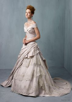 Ian Stuart Wedding Dresses 2013 -- Frederique gown with off-the-shoulder portrait neckline, asymmetrically draped bodice and skirt with tiered lace insert.
