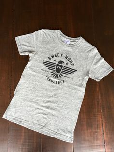 Greetings, home-lovers! Show off your Tennessee pride with our super-soft, super-stylish Home T-Shirts from the original creators of the Home design! These are hand silkscreened Tri-Blend T Shirts wit