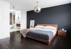 Color Palette. White, blue, wood color of both floors and bed. Bed style.