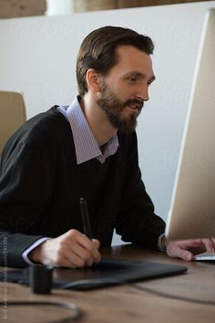 Designer working using graphic tablet at office during the day