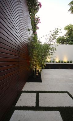 Modern Small Courtyard Design & Renovation Project Scope 'Cement fence' screening design Screening of existing fences Timber Slat screening on boundary wall Feature French Pattern paving at side pathways Lighting...