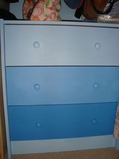 This is the blue ombre dresser I did recently with three paint colors next to each other on the paint samples. This was done on an IKEA RAST dresser. Ombre furniture is so fun and easy!