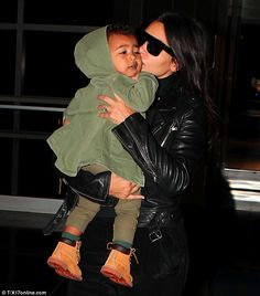 So much love: Kim Kardashian couldn't get enough of baby North as they arrived in Philadelphia on Saturday