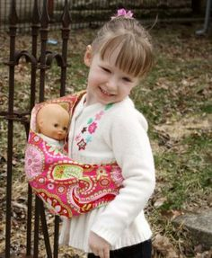 "Snuggy Baby Child's Doll Sling Baby Doll Carrier -Pink Paisley by Snuggy Baby. $13.00. Fun kid friendly prints. Pouch style sling for child to carry their favorite doll or toy. Easy to use becuase there are no buckles or ties. For ages 2-5. Great gift for a new sibling. Girls just want to have fun, and with this playful doll sling she sill do just that. Let your child play mommy with her dolls by carrying them in her very own doll sling. Although this is a ""ba..."