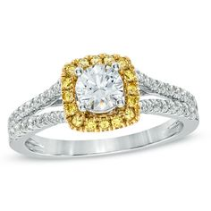 A squared frame of sunny yellow accent diamonds set in warm yellow gold surrounds the center stone, while shimmering white diamonds grace the ring's double shank.