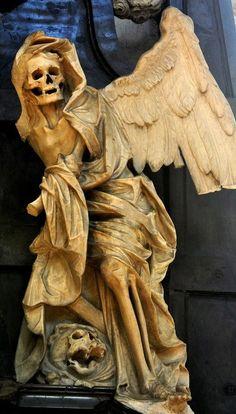 Epitaph sculpture in Pere Lachaise Cemetery; Paris