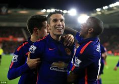 Robin van Persie (centre) celebrates his winning goal against Southampton at St Mary's on Sunday night