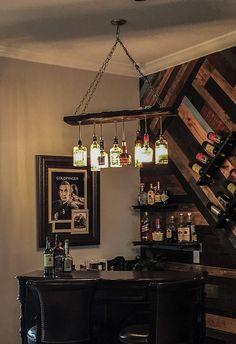 31 must have items for the ultimate man cave 27 Liquor Bottle Lights, Wine Bottle Chandelier, Liquor Bottles, Dining Room Lighting, Bar Lighting, Zigarren Lounges, Home Bar Designs, Man Cave Bar, At Home Store
