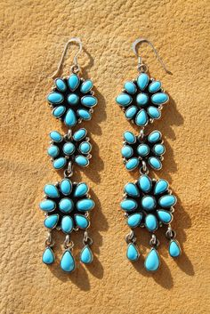 Earrings | Emma Lincoln (Navajo).  Sterling silver and sleeping beauty turquoise.