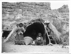 Two Havasupai Indian women in front of native dwelling Havasu Canyon ca 1899