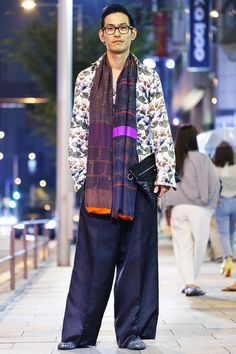 Aoyama, TOKYO. Akito Hata, researcher. Dries Van Noten shirt, Comme des Garçons pants, Pierre-Louis Mascia scarf, Balenciaga bag, Jimmy Choo shoes, Givenchy ear accessory, Tom Ford glasses. Photo Steve West