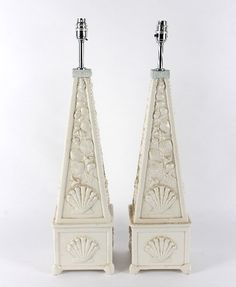 A pair of Casa Pupo white glaze lamps of obelisk shape with moulded shell decoration - Dim: 54cm high excluding fitting