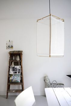 Frame with cloth over pendant light. Variations abound.