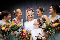 Image by Joe Stenson Photography - East Riddlesden Hall barn wedding venue in Yorkshire with a vintage dress, colour pop florals and BHS Bridal bridesmaid dresses by Joe Stenson Photography