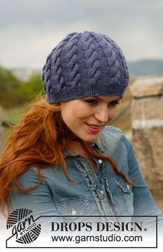 "Knitted DROPS hat with cables in ""Karisma""."