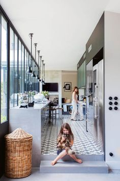 This stunning French house is home to a family of seven. The century build was revamped over nine months to create modern interiors that accommodate this large family and their lifestyle. Galley Style Kitchen, Family Kitchen, Style At Home, French Chateau Homes, Küchen Design, House Design, Edwardian Haus, Weatherboard House, Art Deco Home