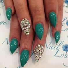 cute teal and silver stiletto nails