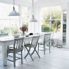 This conservatory extension has a wonderfully bright feel thanks to its fresh decor in shades of white and grey.