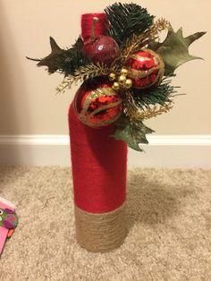 Wine bottle I made for Christmas! Wine Bottle Candles, Wine Bottle Art, Painted Wine Bottles, Wine Bottle Crafts, Christmas Crafts To Make, Holiday Crafts, Christmas Wrapping, Wrapped Wine Bottles, Christmas Flower Arrangements