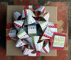 Tutorial - Make your bow from 12 x 12 scrapbook paper or double sided wrapping paer.