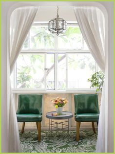 Green accent chairs. I've always wanted to put curtains in the entrance of my formal living and dining rooms!