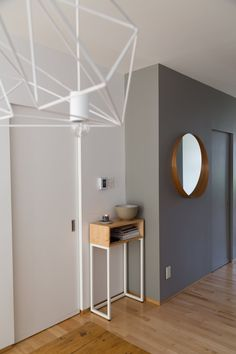 Hallway leading into dining room. Console from De Gaspé. Stockholm mirror from IKEA.