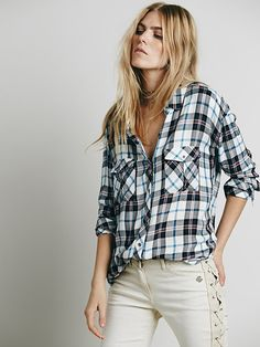 If I didn't already own 4 plaid button down shirts I would buy this. Free People Draped in Plaid Shirt, $128.00