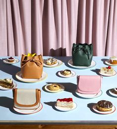 It's only natural for The Man @aaron_tilley to serve @mansurgavriel pastries like a boss  amazing #setdesign as always  #thegourmand #mansurgavriel #stilllife #bucketbag by beyondthemag