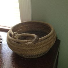 Basket I made from an old lariat rope. Use soldering iron to melt rope here and there on inside. This is what holds it together. These are weatherproof.