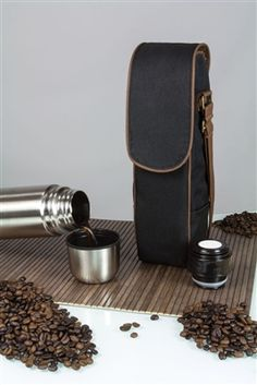 Kona Express Coffee Tote. Transporting your hot coffee or tea just got easier with the Kona Express. Prepare your hot beverage, pour it into the 24-oz. stainless steel vacuum flask, place the flask in the duffel, and you're ready to go! The Kona Express duffel is made of black, durable polyester with brown trim and has an adjustable shoulder strap. #coffeetote #thermus #picnic Protein Powder Coffee, Vacuum Flask, Brown Trim, Hot Coffee, Leather Backpack, Beverage, Shoulder Strap, Picnic, Stainless Steel